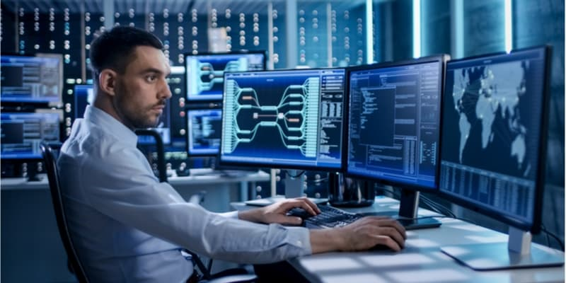A data engineer working on his computer.