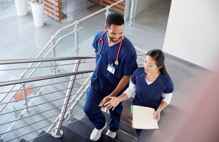 two nurses walking up the stairs
